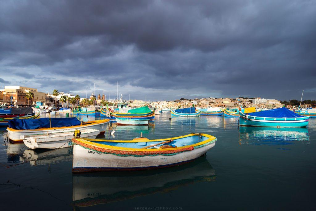 Gloomy sky over fisher village Marsaxlokk, Malta