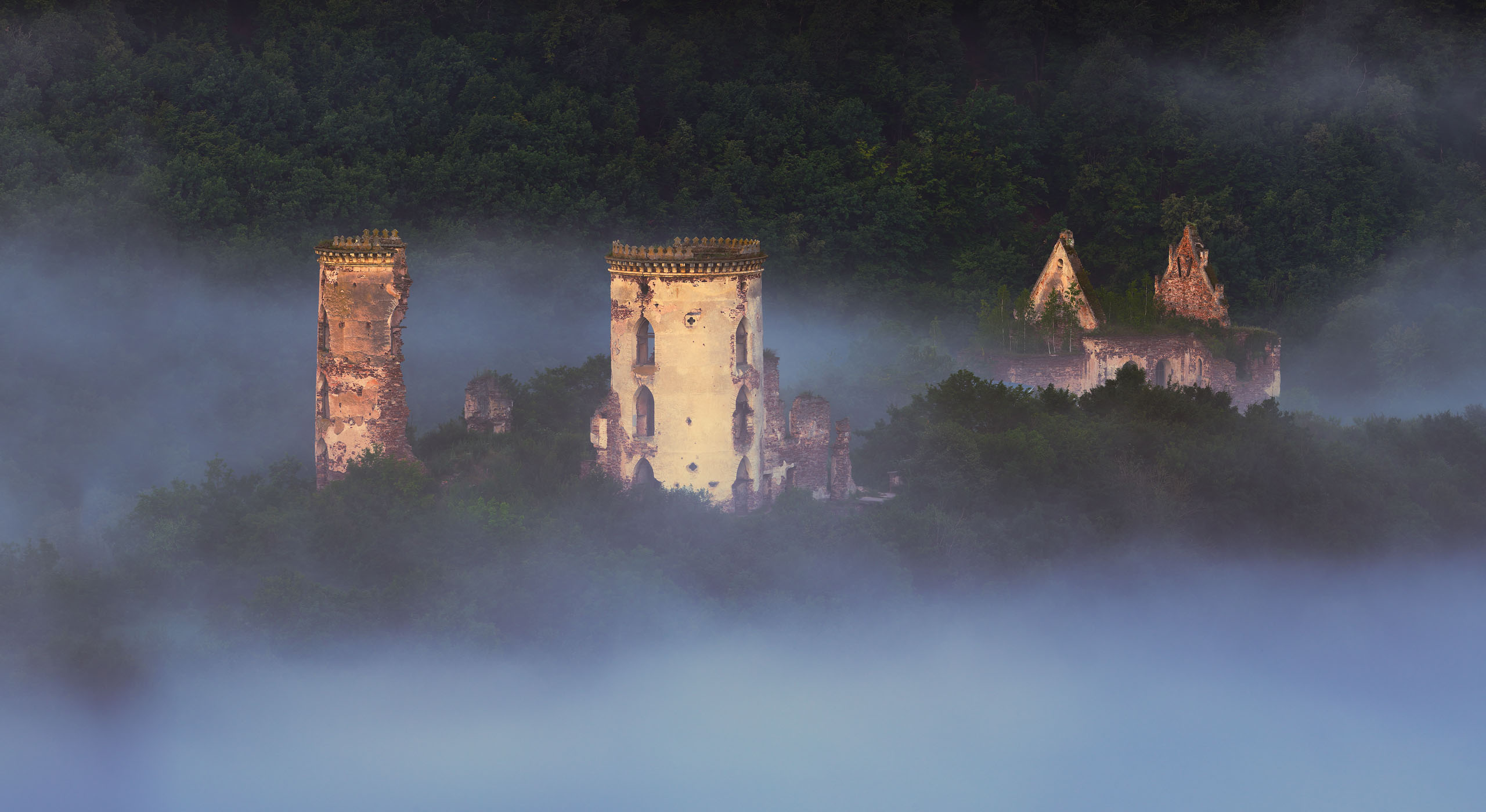 Panoramic view of Chervonohorod castle in mist