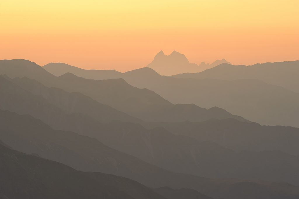 Ushba in the morning sun. Caucasus mountain silhouette.