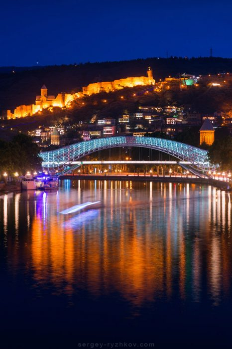 Bridge of Peace and Narikala Fortress at night. Tbilisi, Georgia