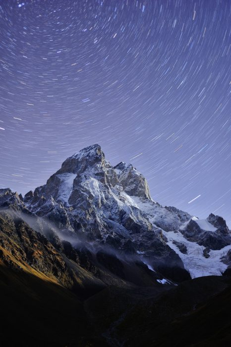 Ushba Mountain with star trails. Evlira Podolinska
